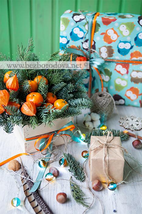 Новогодняя композиция из ели с мандаринами
